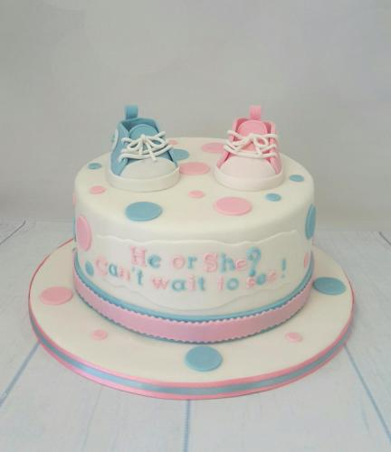 Spots and Baby Trainers Gender Reveal Cake.