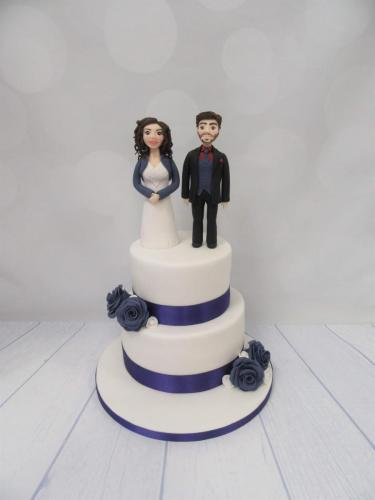 Purple Rose with Bride and Groom tiered Wedding Cake.