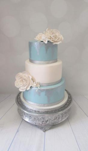 Blue and Silver tiered Rose Wedding Cake.