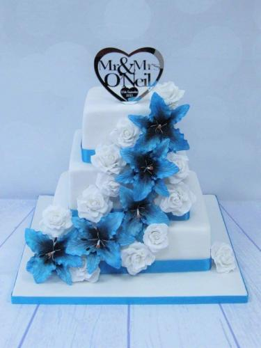 Blue Stargazer Lily and Roses square tiered Wedding Cake.