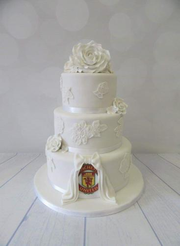 Football badge and Roses round  tiered Wedding Cake.