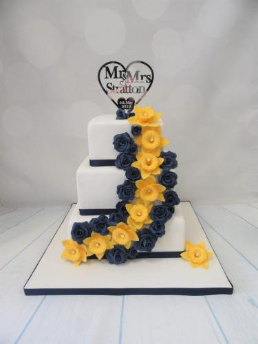 Daffodil and Roses square tiered Wedding Cake.