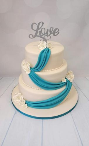 Turquoise Drapes and Roses round  tiered Wedding Cake.