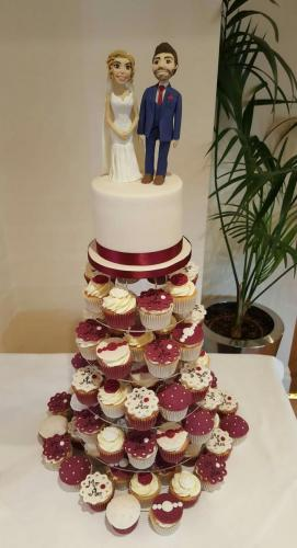 Claret colour scheme Wedding Cake with matching Cupcakes.