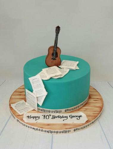 Acoustic Guitar with Sheet Music Cake.